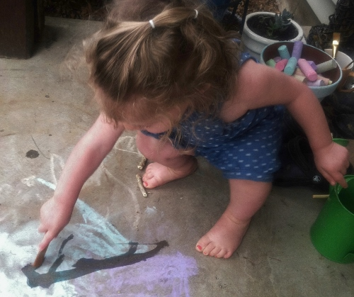 Painting with water and chalk.