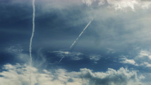 Clouds and plane trails