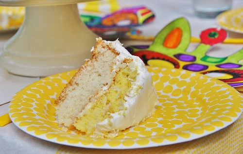Yum! White boxed cake mix jazzed up with a little lemon zest and almond extract!