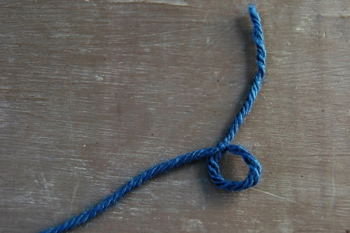 A circle shape held together with a knot