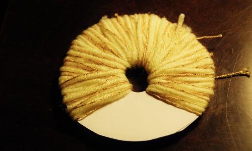 Wrap yarn around the ring.