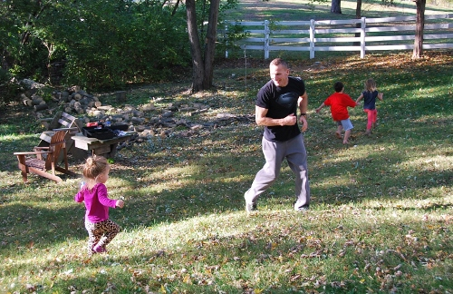 Baby playing tag with her uncle
