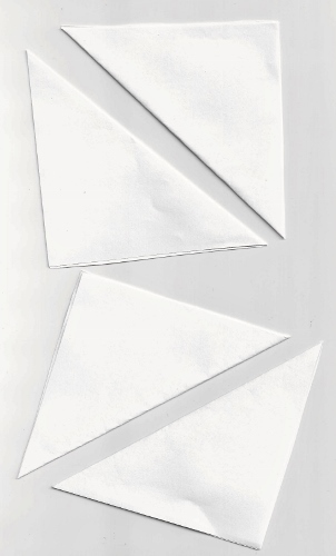 Fold the squares in half diagonally.