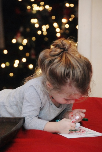 Baby working hard on her Christmas cards.