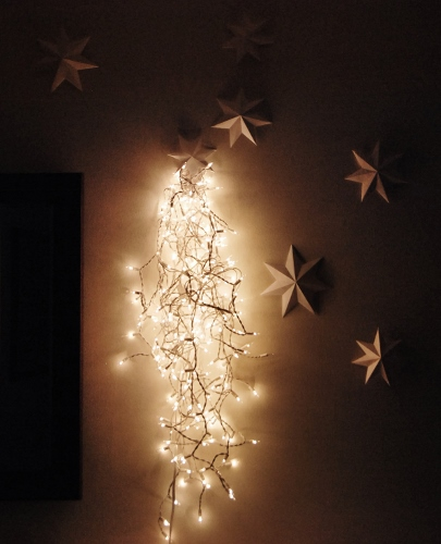 Seven Seven-Sided Paper Stars and a String of White Lights