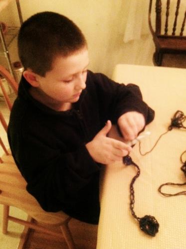 The Spy making a crocheted yo-yo