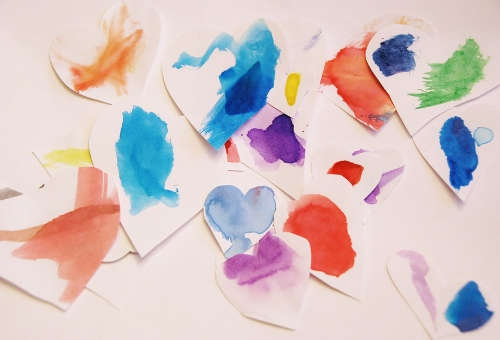 heart shapes out of paper that's been drawn/painted on...
