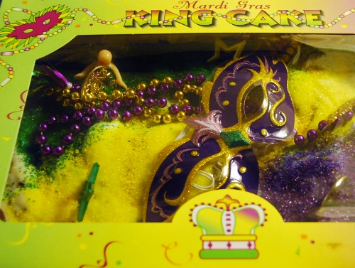 King Cake...yes, that's a plastic baby and yes, that baby is supposed to be INSIDE the cake (we fixed that)