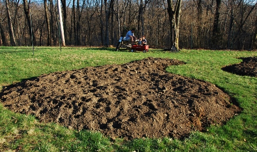 """And we all took breaks in our designated """"Garden Living Room"""" (pictured beyond the new whistle-shaped plot)."""