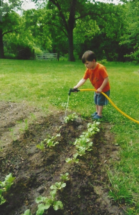 A much younger Spy watering a much smaller garden in a Mayo a few years ago!