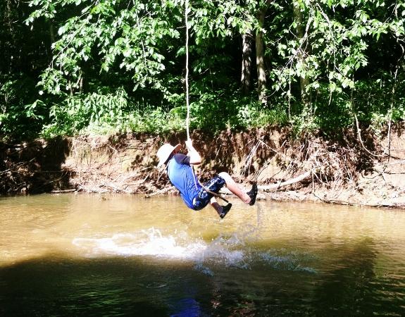 Swinging on a vine.
