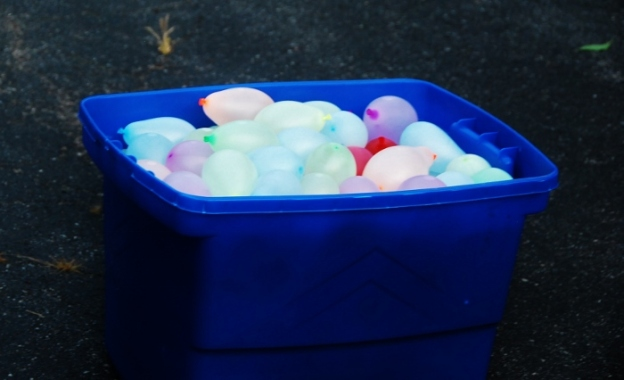 There were about seven big bins full of water balloons!