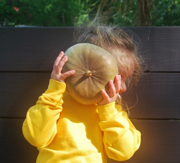 "Struggling with the ""hold the pumpkin in front of your face"" concept."