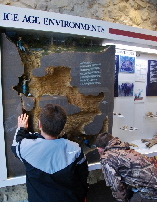 The Spy and his friend checking out an exhibit about Heinze Cave