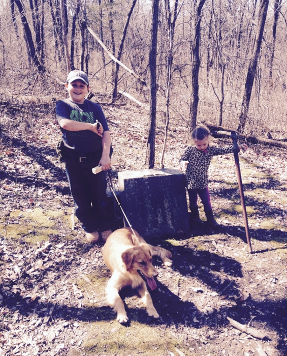 From their long hike in Babler State Park; posing next to an old gravestone in the woods