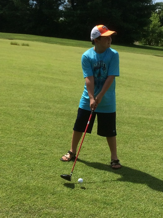 The Spy golfing