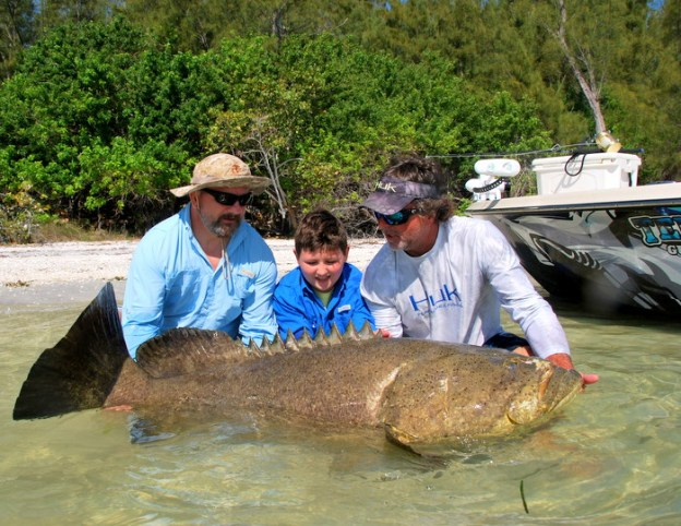 Checking it out: it is a Goliath Grouper (and that guy is a fishing guide)