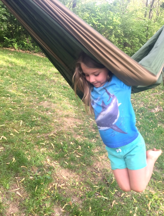 Baby does all sorts of tricks with this Eno hammock