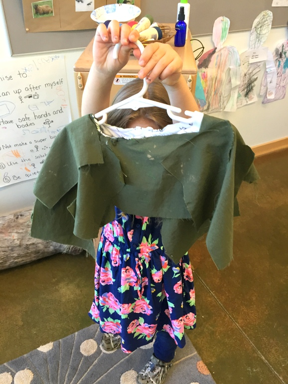 Part of her homemade camo gear (used to hide in the forest to spot animals!)
