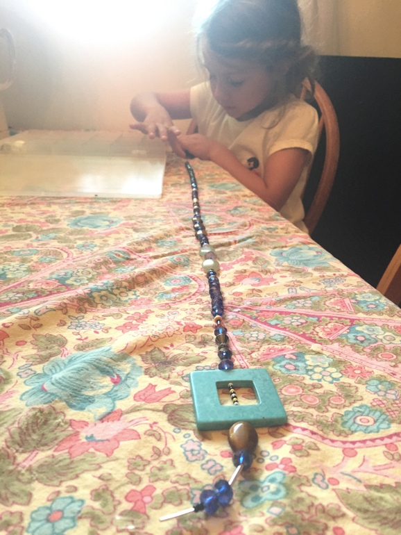 Making a necklace for Nana's birthday! She is really into beading lately.