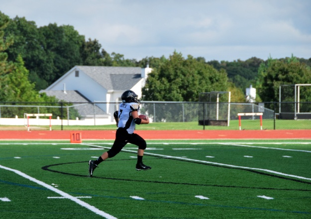 Scoring a touchdown (one of three!) in the first official game of the season!