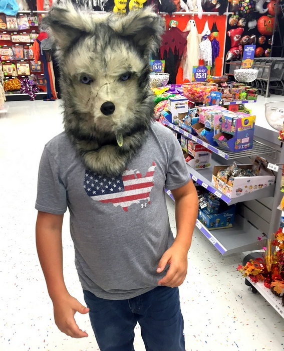 Checking out the masks at Party City