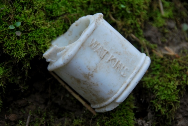 A very thick white milkglass jar found in the woods